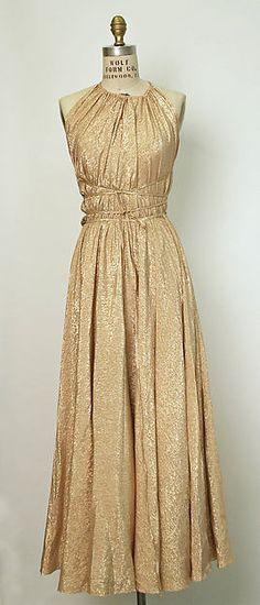 metallic gold Grecian gown, sleeveless; Halston 1978