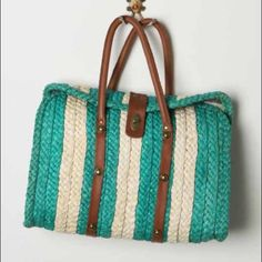 """Anthropologie Village Green Bag by Pilcro Take an outdoor excursion and fill your leather structured straw satchel with nibbles, necessities and other niceties. By Pilcro. Three inner pockets Turnlock closure Straw, leather; cotton lining 12""""H, 15.5""""W, 3.75""""D 8"""" strap drop  Brand new without tags! It was ordered online and didn't come with tags and I did not keep the plastic bag it came in. But it has never been used and in original Condition.  No Pay Pal Smoke and Pet Free Home All…"""