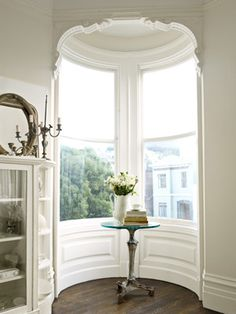 A Quiet Front Window  Rosy Strazzeri-Fridman added a glass top to the vintage Art Nouveau table base that occupies her home's turret.   San Francisco Victorian Homes - White Victorian Home Decor - Country Living