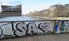 Spanish graffiti plastered onto glass panels of iconic Paris bridge