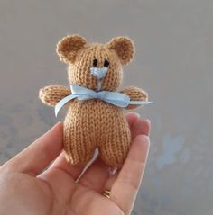 This little knitted bear is quick and easy. Made with oddments of brown double knitting yarn, a length of blue and black. A short piece of ribbon and a small amount of toy stuffing. Knitting Bear, Teddy Bear Knitting Pattern, Knitted Teddy Bear, Crochet Bear, Double Knitting, Start Knitting, Knitting Toys Easy, Free Knitting, Crochet Toys