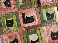 Log Cabin cat blocks.... absolutely adorable. With some of the Moda 30's fabrics this would make a great baby quilt.