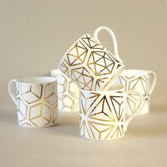 I've just found Set Of Gold Platonic Solids Mugs. A set of five beautiful white fine bone china mugs hand-decorated with 9 carat gold. Ceramic Mugs, Ceramic Pottery, Shape Names, Mad About The House, Platonic Solid, Solid Shapes, Geometric Decor, Geometric Patterns, China Mugs