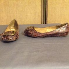 Jessica Simpson snakeskin print flats This is a pair of Jessica Simpson faux snakeskin flats size 6B. They are slip on brown color with buckle across top. They are gently used but in great condition. No box. Jessica Simpson Shoes Flats & Loafers