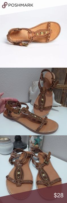 "Zigi Girl Elena Tan Leather T-Strap Sandals 9 These are a pair of Zigi Girl Elena tan leather t-strap sandals in size 9.  The sandals have adjustable straps.  They are in great preowned condition with minimal wear.  Approx. measurements: 1/2"" heel, 10 1/4"" insole length. Zigi Girl Shoes Sandals"