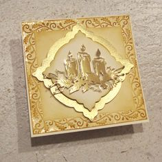 handmade Christmas card ... gold ... candles die cut from gold ... layered label with wide mat of shiney gole ... lovely card ...