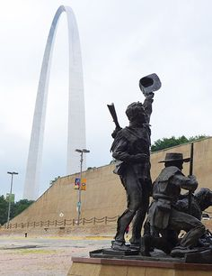 St. Louis, Missouri: A statue of Lewis and Clark with the Gateway Arch.