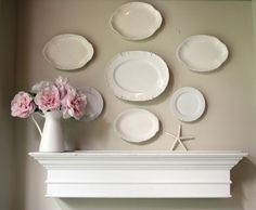 vintage plates arranged beautifully on the wall