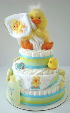 Diaper cake. Stuffed duck can be found at Wal-Mart.  Put some umbrella decorations around it also.