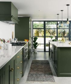 Modern Kitchen Interior Remodeling Green light shaker kitchen with Crittal-style windows - Confused about where to start with your kitchen extension project? From budgeting to planning permission, this article will tell you all you need to know Home Decor Kitchen, Kitchen Interior, New Kitchen, Olive Green Kitchen, Kitchen Yellow, Brass Kitchen, Design Kitchen, Country Kitchen, Kitchen With Window