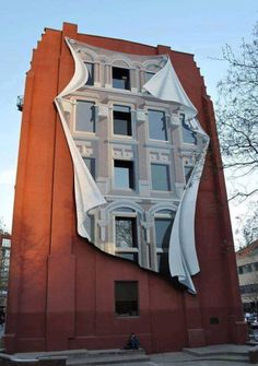 Realistic 3D art illusion on a building. street art graffiti by Patrick Commecy. #otrasdemencias
