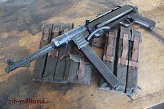German MP40 submachine gun with ammo pouches.
