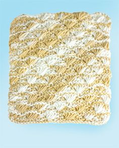 Turn your kitchen into a seaside retreat with this pretty shell stitch dishcloth. Shown in Lily Sugar 'n Cream.