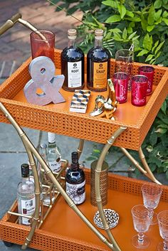 Three cheers for the @SocietySocial Tipple Trolley Bar Cart! It's a twofold treat on wheels with colorful cane trays framed by faux bamboo! #barcarts #fauxbamboo