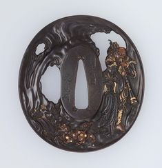 Tsuba with design of foreign musician and sennin with shishi. Japanese Edo period early to mid-19th century - Iwamoto Konkan (1744–1801), Nara Toshinaga (1667–1736) http://www.mfa.org/collections/object/tsuba-with-design-of-foreign-musician-and-sennin-with-shishi-11540