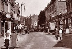 The top of the High Street with Weekes Store and the Railway Bell pub/hotel on the corner of Grove Hill Road in the distance c1910.