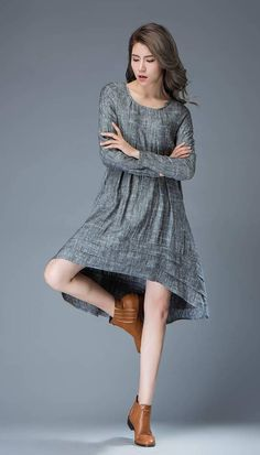 669be012e5 A flattering marl gray linen lagenlook dress cut with extra pleated fabric  that creates additional room