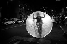 Wayne Coyne of The Flaming Lips rolls down 14th street in a space bubble before performing at the Ray-Ban 75th anniversary party at the Darby in New York on December 5th, 2012.
