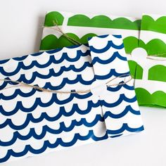 paper bags with the 'hills' and 'waves' patterns, design by Jessica Nielsen for Kadodesign