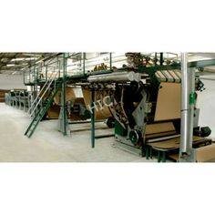 This is In-Line Combined Automatic Paper Corrugated Board Making Plant. It mainly includes Mill Roll Stand, Single Facer, Take -up Unit, Over-head Bridge, Glue Unit, Double Facer, Slitter Scorer, Cut-off and plant, it has auxiliary equipments which includes Steam (or oil) Heating System, Glue preparing and supplying system, Rails and carriages, Main Drive, Preconditioner, Multi pre-heatre, Electrical Control provided.