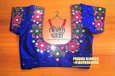 Beautiful royal blue color designer blouse with flower design hand embroidery mirror work.
