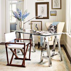 masculine + feminine workspace.  directors chair + gallery wall + chrome sawhorse desk