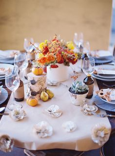 The colorful flowers, the yarn wrapped plate chargers, the rustic details...this is the perfect #table for a warm autumn #wedding!  Natural and Cozy Tablescape by http://carterandcookeventco.com/blog/decor/natural-cozy-tablescape/  Photo Credit: http://jillthomasphotography.com/