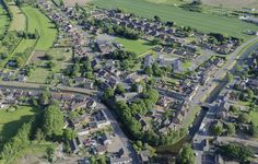 Outwell in Norfolk - St Clement's church aerial image   by John D F