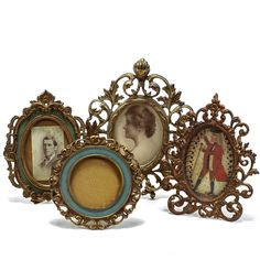 Group of four cast metal antique Victorian stand up picture frames.