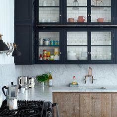 Marble or concrete? REModern-kitchen-with-grey-cabinetry-and-wooden-cupboards