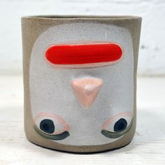 This is myrorypot. It's the same as myadampot but the face is up-side-down. The pot is cast in a speckled gray clay and hand painted with colorfast matte glazes. All production is done here in my brooklyn based studio. Pots are great for plants, keys, pencils, change, etc.
