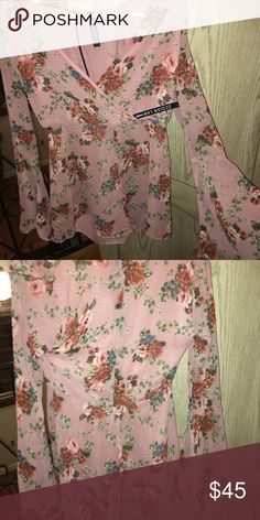 Pink Floral Romper Never worn with tag still on. Chiffon romper with bell sleeves Design Lab from Lord & Taylor Other