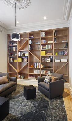 A modern home library with a large shelving unit and grey furniture plus some lights. Bookshelf Design, Bookshelves Built In, Book Shelves, Bookshelf Decorating, Bookshelf Ideas, Library Shelves, Decorating Ideas, Interior Decorating, Home Library Design
