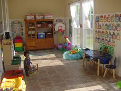 preschool room - love this! Kid friendly floors, and love how the paint color on the walls brings everything lower to a child's level.