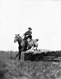 President Theodore Roosevelt on horseback jumping over wall. May 29th 1907.