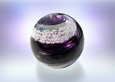 Artful Ashes collects one tablespoon of your loved one's ashes to include them in a glass orb and or heart.