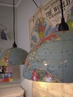 Use half an old globe for a light. Use the other half underneath on the table as a bowl centerpiece!