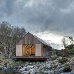 'NAUST PAA AURE' BOATHOUSE / TYIN TEGNESTUE ARCHITECTS - This beautifully simple boathouse in the remote Aure Kommune region is the work of local Norwegian architects TYIN tegnestue. Commissioned to replace an outdated and broken-down boathouse, the design studio embarked on a mission to reuse as much physical material from the existing building as possible...