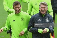 Thomas Mueller (R) of Germany smiles with his team mate Bastian Schweinsteiger (R) during a team Germany training session ahead of the UEFA EURO 2016 Group C match between Northern Ireland and Germany at Stade Parc de Princes on June 20, 2016 in Paris, France.