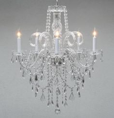 "Authentic All Crystal Chandelier Chandeliers H30"" X W24"". This Beautiful Chandelier Is Trimmed With CrystalA Great European Tradition. Nothing Is Quite As Elegant As The Fine Crystal Chandeliers That Gave Sparkle To Brilliant Evenings At Palaces And Manor Houses Across Europe. This Beautiful Crystal Chandelier Is Decorated With 100% Crystal That Capture And Reflect The Light Of The Candle Bulbs, Each Resting In A Scalloped Bobache.The Timeless Elegance Of This Chandelier Is Sure To Lend A…"