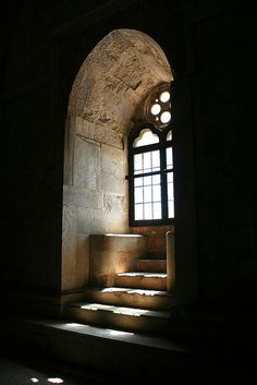 Curved castle window with a stone seat. Castel del Monte, Italy, built in the 13th century. Photo by Alessandro Recchiuti.
