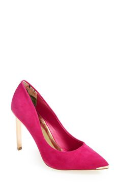 Pretty pink pumps with gold accents.
