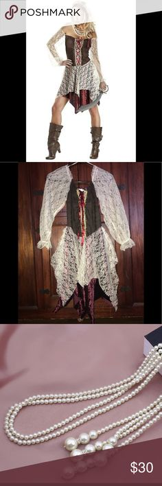 Pirate Halloween costume ⚔️📿🧟♀️ 🎃👻 I only worn this once. The costume includes a dress with a handkerchief skirt and head tie. Size small. Items not included are sword, and boots. Pair up with the Rouge Pirate for a couples look.  - Includes Dress With Handkerchief Skirt, Head Tie, pearl necklace   - This product is a 2PC Set - 100% Polyester - hand wash, cold water, line dry, no dryer, no bleach. Dresses