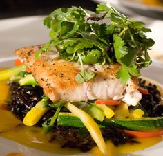 Pan-seared Amberjack with forbidden black rice in a saffron citrus sauce is a delectable way to nourish yourself while at the same time supporting local NC seafood. We recommend this Louisiana Cookin' recipe!