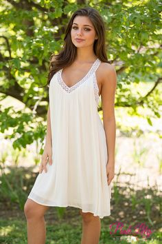 This dress is just your type and more! We are loving the color and the white lace detail! Not to mention the comfy feel! Pair this with wedges to finish off a perfect look!