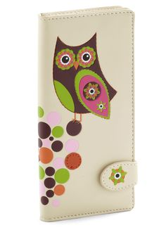 "Just for Funds Wallet...""Add a playful touch to your pocketbook by keeping your cash in this vegan-friendly wallet! Adorned with a psychedelic owl and its pop art perch, this colorful billfold flaunts adorable details you can bank on. Pop this multi-pocketed pouch in your brightly colored purse, slip on some '60s-inspired sunnies, and wrap a vibrant scarf around your neck, and you'll surely spend the day smiling!"" Plus, there's a tree on the back with circle leaves...so very cute!"