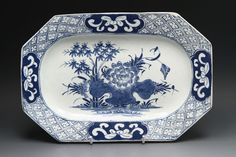 A good Bow porcelain platter c 1762-5  A nice Bow hexagonal platter 27.5 cms x 19 cms.  Painted in underglaze blue with the Bamboo Peony pattern.  Painters mark 17 underneath.  Filled chip to corner and filled and overpainted chip and another small chip to the rear. £59