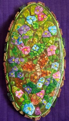 https://flic.kr/p/4fHeFc | Egg Shell Garden Mosaic | Butterfly in flower garden. Three layers of egg shell, painted with acrylics, framed with handmade stones from hypertufa which was colored with cement dye and set with thinset which was later painted green. Sealed with acrylic gloss sealer.  Recycled items:Thrift store wooden plaque, egg shells.