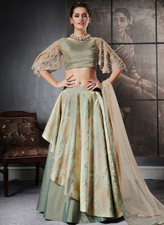 Give in to the exotic confluence of today and tomorrow in this beautiful attire. Add richer looks to your persona in this majestic green jacquard silk lehenga choli. Beautified with fancy work all synchronized well with the pattern and design of the attire. Comes with matching choli and dupatta. (Slight variation in color, fabric & work is possible. Model images are only representative.)
