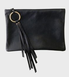 This lovely black leather clutch is one that actually makes the transition from day to night, and does so quite gracefully, too.